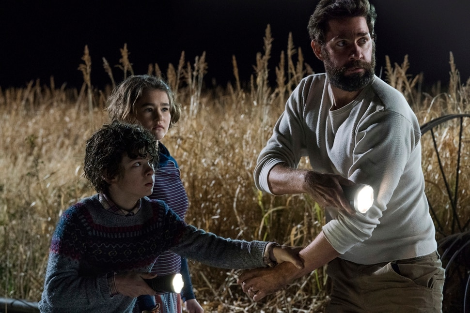 "This image released by Paramount Pictures shows Noah Jupe, from left, Millicent Simmonds and John Krasinski in a scene from A Quiet Place. With just a $17 million budget, John Krasinski's horror hit grossed $340.7 million worldwide. It was the biggest original hit of a year typically dominated by sequels, superheroes and reboots. Of course, ""A Quiet Place"" will get its own sequel, slated for release in 2020. (Jonny Cournoyer/Paramount Pictures via AP)"