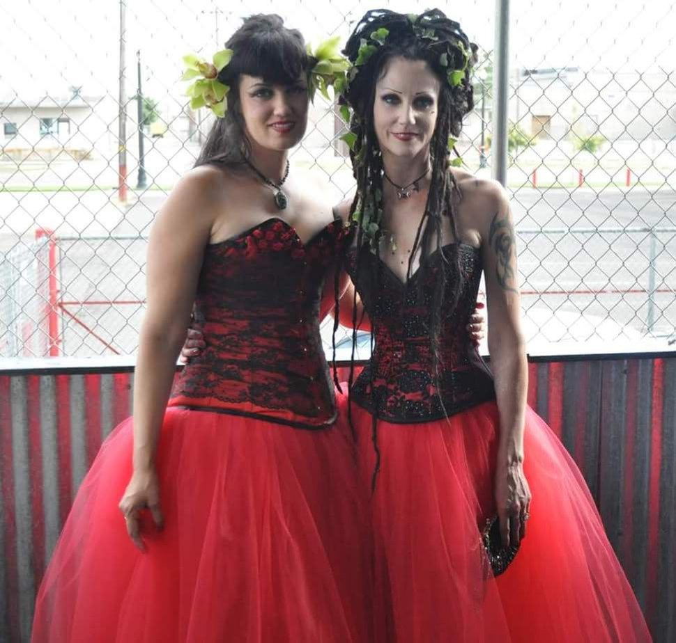 (Courtesy photo) Megan Dinnell (aka Olivia Megsysi) and Cinamon Hadley at their wedding reception, wearing matching wedding dresses made by friend and fashion designer Cas Reich.