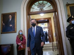 (J. Scott Applewhite | AP file photo) Sen. Mitt Romney, R-Utah, arrives at the Senate on Jan. 26, 2021.