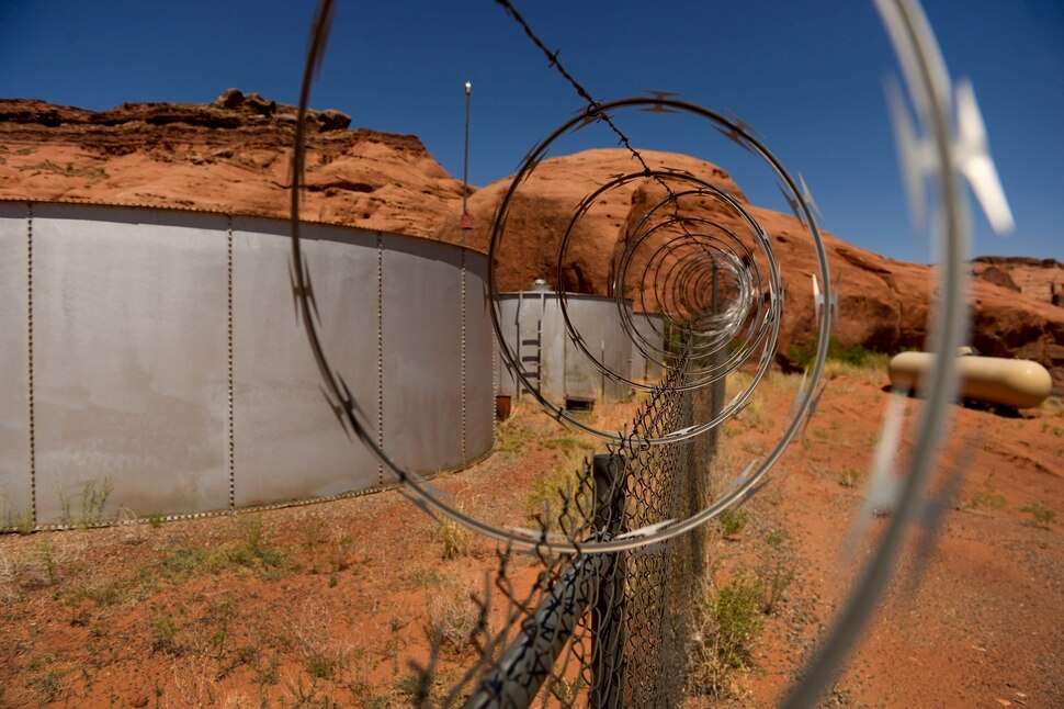(Leah Hogsten | The Salt Lake Tribune) Water tanks that supply water at Goulding's Lodge, grocery store, gas station, RV park and campground are surrounded by razor wire in Oljato-Monument Valley, San Juan County, June 22, 2020.