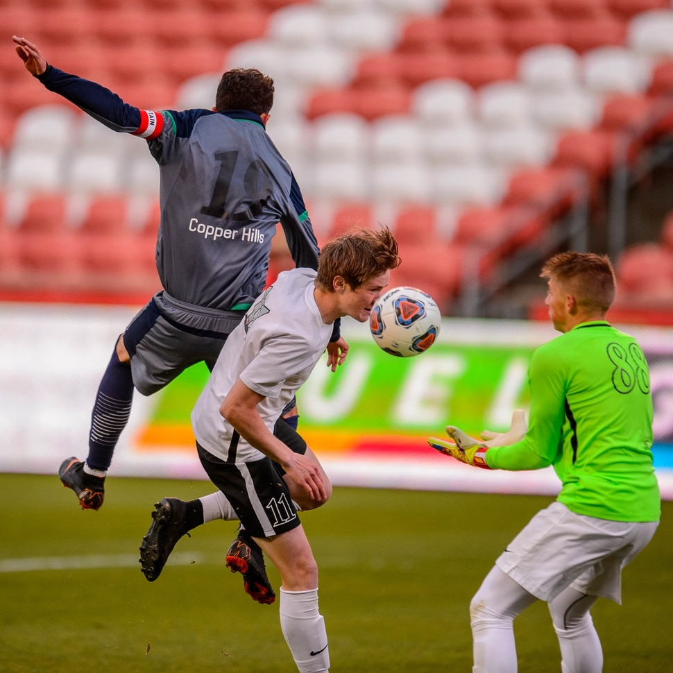 (Trent Nelson | The Salt Lake Tribune) Weber goalkeeper Charles Wheelwright makes a save with help from Tate Bartholomew as Weber faces Copper Hills High School in the 6A boys state championship game at Rio Tinto Stadium in Sandy, Thursday May 23, 2019. At left is Copper Hills's Kevin Lopes (19).
