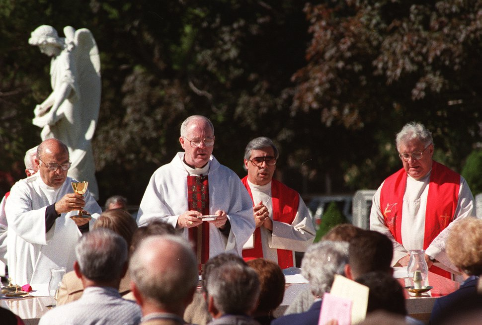 | Tribune File Photo Catholic Bishop George H. Niederauer at Memorial Day Mass at Mt. Calvary Cemetery on May 27, 1996.