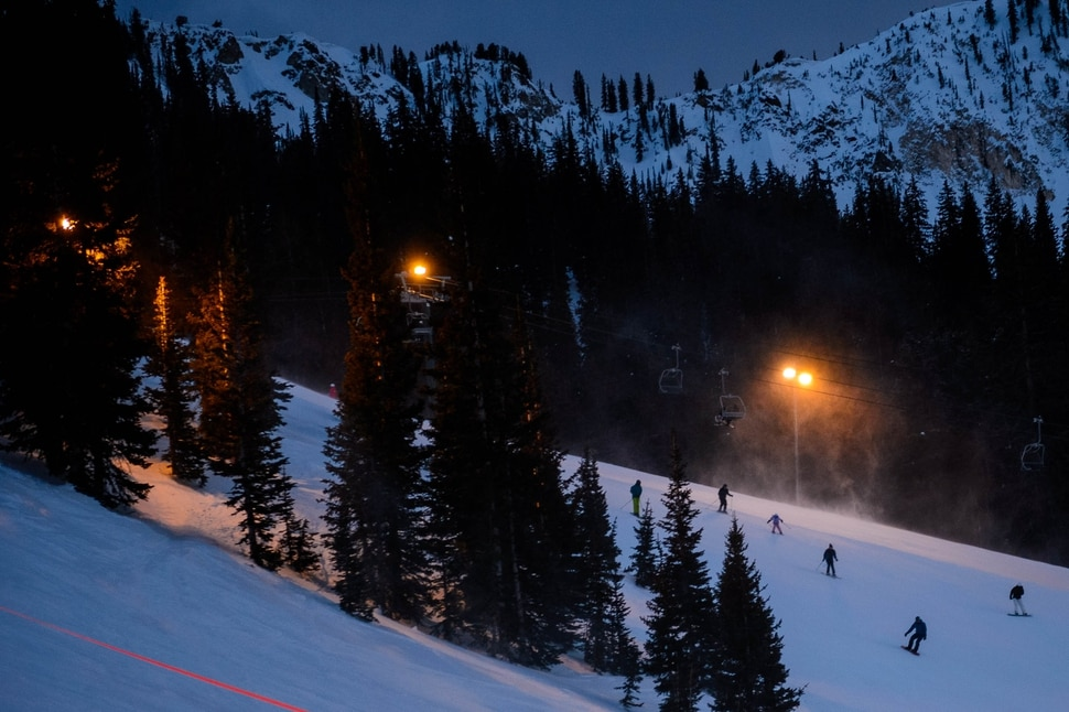(Trent Nelson | The Salt Lake Tribune) Snowboarders and skiers on the slopes at Brighton during night skiing hours on Monday, Feb. 24, 2020.