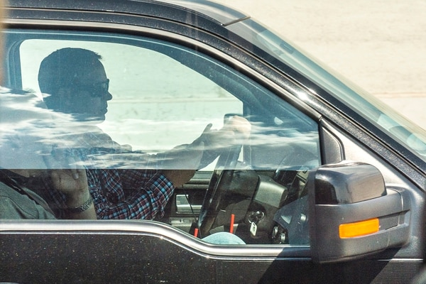 Chris Detrick | The Salt Lake Tribune A driver uses his cellphone while driving on Interstate 15 Thursday, July 13, 2017.