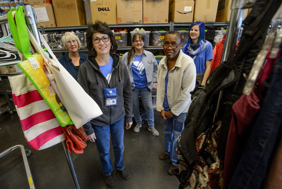 (Steve Griffin | The Salt Lake Tribune) Volunteers Peggy Montrone, Kathy Wagner, De Buchanan, Erma Decaria and Natalie Bagnell in the donation room at Volunteers of America, in Salt Lake in Salt Lake City Monday December 11, 2017. The group volunteers their time to organize donated items intended for homeless young people.