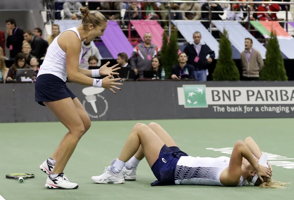 United States' CoCo Vandeweghe, right, and her teammate Shelby Rogers, left, celebrate after defeating Belarus' Aliaksandra Sasnovich and Aryna Sabalenka during the Fed Cup final match between Belarus and USA, in Minsk, Belarus, Sunday, Nov.12, 2017. United States defeated Belarus 3-2 and gained the Fed Cup title. (AP Photo/Sergei Grits)