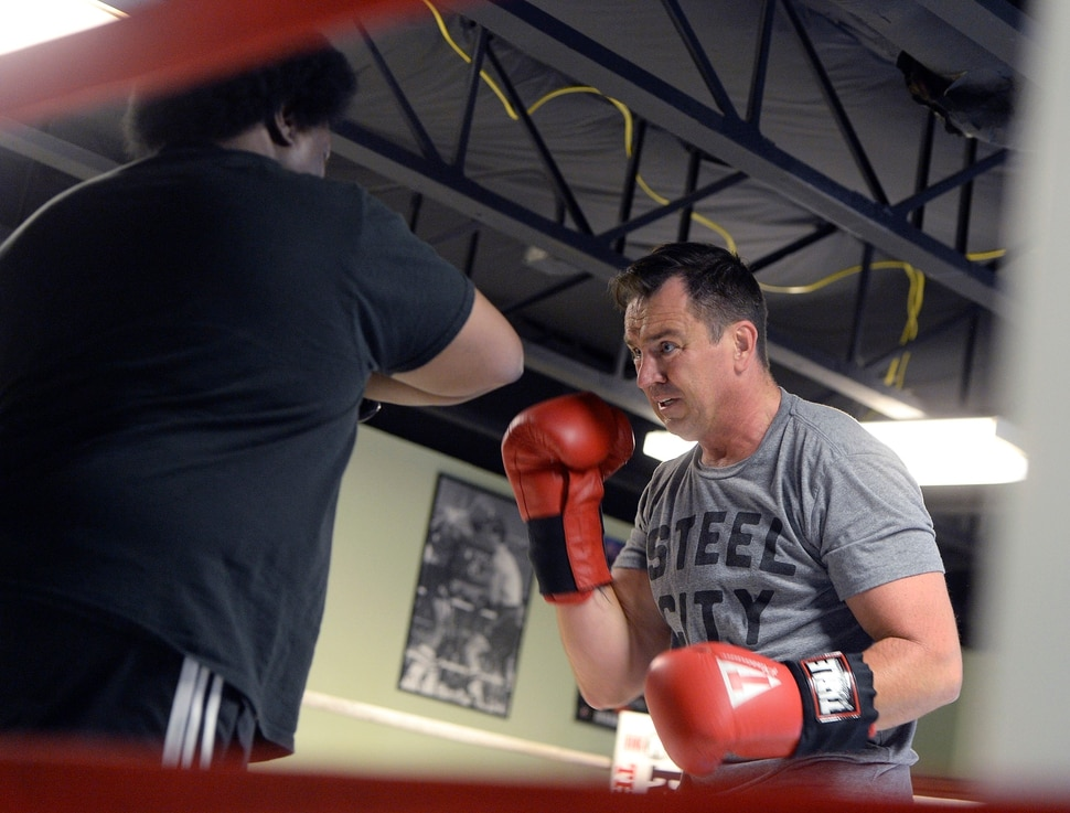 (Al Hartmann | The Salt Lake Tribune) House Speaker Greg Hughes spars with Eddie Flash Newman during his workout at the Flash Academy gym in Holladay Tuesday August 29. He's among a handful of local politicians, police and lobbyists who will box in a series of charity matches to benefit a national group that works to end domestic violence.