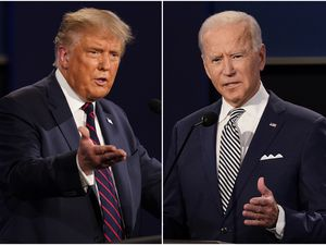 (AP Photo/Patrick Semansky, File) FILE - This combination of Sept. 29, 2020, file photos shows President Donald Trump, left, and former Vice President Joe Biden during the first presidential debate at Case Western University and Cleveland Clinic, in Cleveland, Ohio. Trump and Biden have starkly different visions for the international role of the United States — and the presidency. A new survey reports former President Donald Trump expanded his robust support among white evangelicals in the 2020 election, but President Joe Biden won in part by making significant gains among Catholics and non-evangelical Protestants.