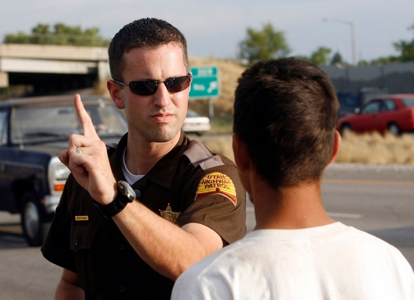 (Al Hartmann | Tribune file photo) In this 2006 photo, then-UHP trooper Joseph Osmond gives a field sobriety test to a driver on Interstate 15 in Salt Lake County. A filled marijuana pipe and open beer bottle were found in the search of the vehicle earlier. The driver was found to be sober.