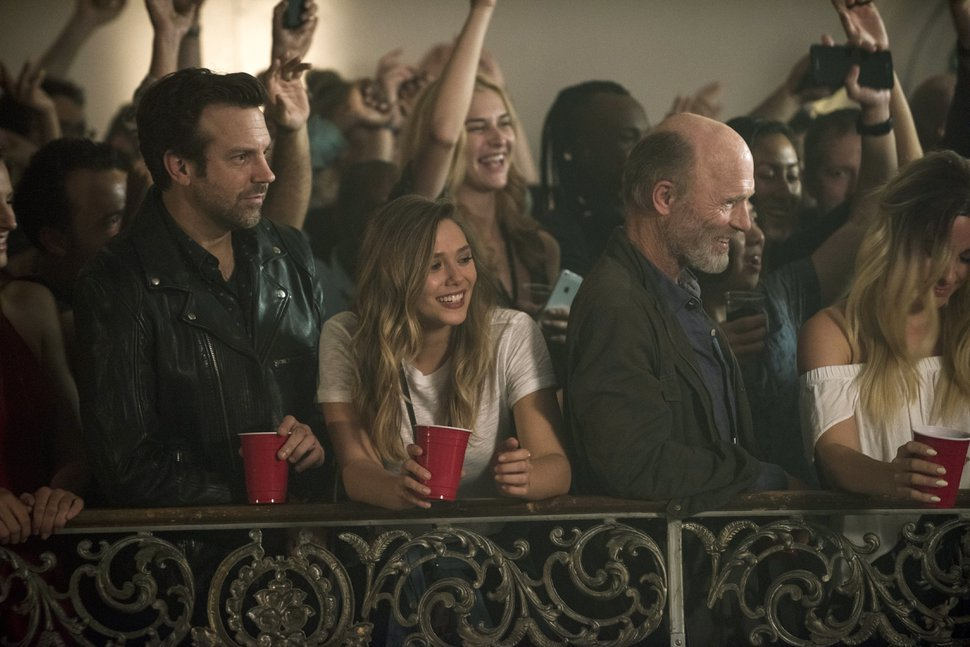 Jason Sudeikis, from left, Elizabeth Olsen and Ed Harris in a scene from