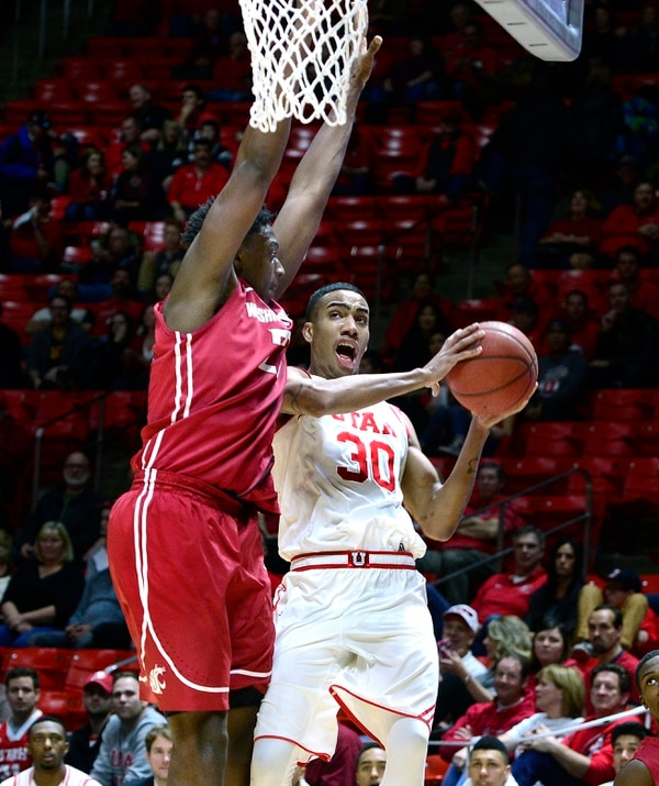 Scott Sommerdorf | The Salt Lake Tribune Utah Utes center Makol Mawien (40) scores on a drive past Washington State Cougars forward Washington State Cougars forward Robert Franks (22) late in the second half. Utah defeated Washington State 88-47, Sunday, February 14, 2016.