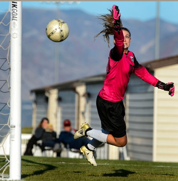 (Steve Griffin | The Salt Lake Tribune) Copper Hills goal keeper McCaslin Davis stretches for a shot on goal during the Class 6A girls' soccer playoff game against Davis at Copper Hills High School in West Jordan Tuesday October 10, 2017.