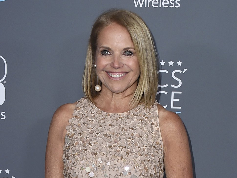 FILE - In this Jan. 11, 2018 file photo, Katie Couric poses in the press room at the 23rd annual Critics' Choice Awards in Santa Monica, Calif. NBC is bringing back Katie Couric to co-host the opening ceremony of the Winter Olympics next month. She will be co-host with Mike Tirico, who is replacing Bob Costas as prime-time host of the games. The ceremony will take place in South Korea on Feb. 9. (Photo by Jordan Strauss/Invision/AP, File)