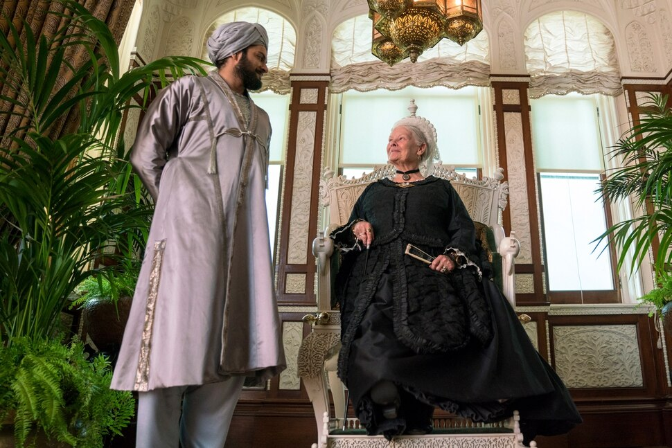 (Peter Mountain | courtesy Focus Features) Queen Victoria (Judi Dench, right) talks with Abdul Karim (Ali Fazal), an Indian Muslim who became her confidant in her final years, in director Stephen Frears' Victoria and Adbul.