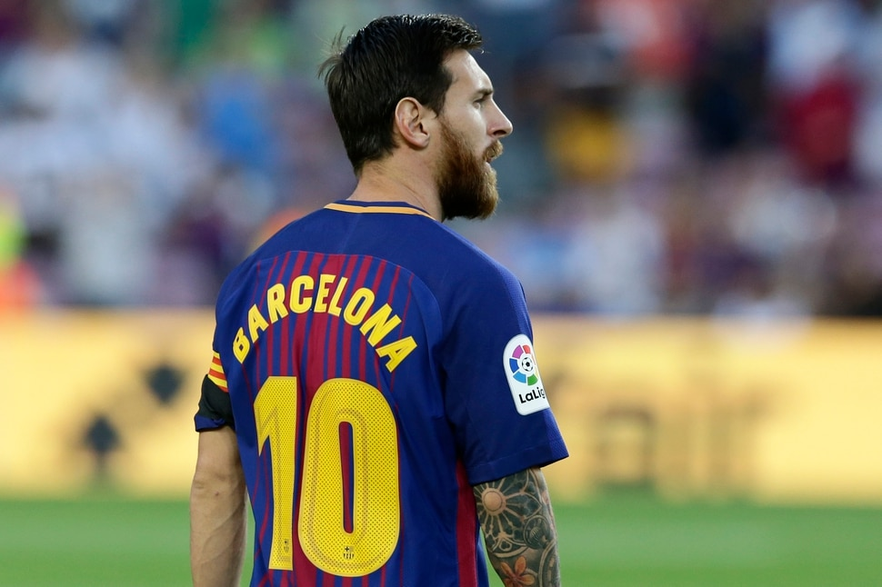 8f37df77791 Barcelona s Lionel Messi wears a shirt with  Barcelona  on his back instead  of his. FC Barcelona s ...