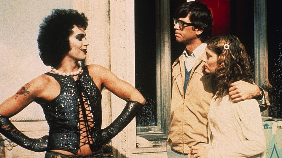 (Courtesy 20th Century Fox) Newly engaged Brad Majors (Barry Bostwick, near right) and Janet Weiss (Susan Sarandon, right) encounter the strange Dr. Frank N. Furter (Tim Curry, left), in a scene from the 1975 cult classic The Rocky Horror Picture Show.