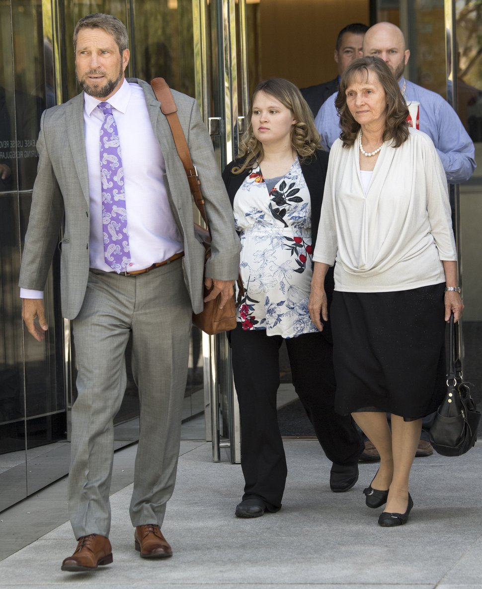 (Rick Egan | The Salt Lake Tribune) Attorney Scott C. Williams leaves the federal courthouse along with Carrie Kingston, wife of Isaiah Kingston, and Isaiah's mother, Rachel Ann Kingston, after a hearing for defendants, Jacob and Isaiah Kingston Wednesday, Aug. 29, 2018.