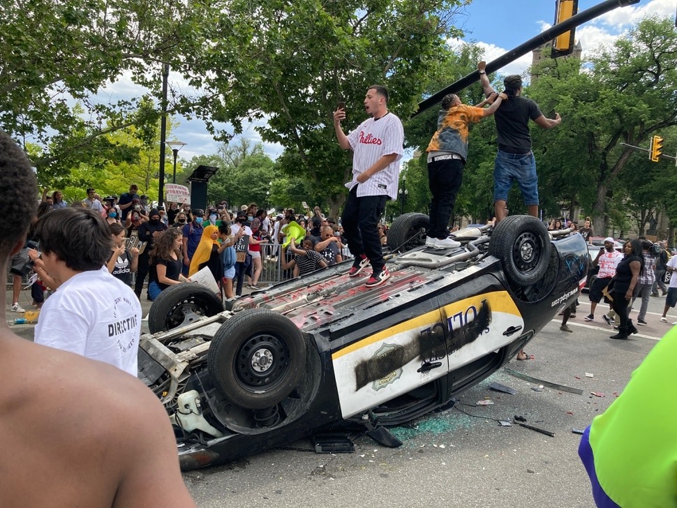 (Trent Nelson | The Salt Lake Tribune) Protesters destroy a police car in downtown Salt Lake City on May 30, 2020.