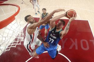 (Gregory Shamus | AP) Slovenia's Luka Doncic (77) drives to the basket past France's Rudy Gobert (27) during a men's basketball semifinal round game at the 2020 Summer Olympics, Thursday, Aug. 5, 2021, in Saitama, Japan.