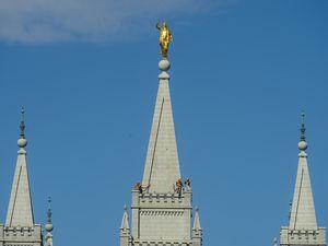 (Rick Egan     The Salt Lake Tribune)    Workers on the spire of the Salt Lake Temple, Tuesday April 21, 2020