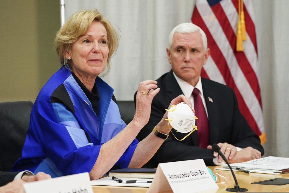 Glen Stubbe/Star Tribune via AP, File) In this March 5, 2020, file photo, Dr. Deborah Birx, ambassador and White House coronavirus response coordinator, holds a 3M N95 mask as she and Vice President Mike Pence visit 3M headquarters in Maplewood, Minn.