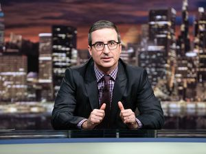 """This March 3, 2019 photo released by HBO shows John Oliver, host of """"Last Week Tonight with John Oliver."""" (Lloyd Bishop/HBO via AP)"""