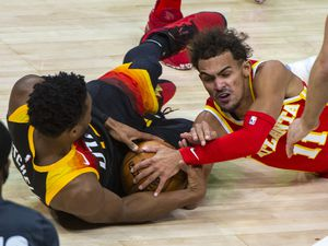 (Rick Egan | The Salt Lake Tribune) Atlanta Hawks guard Trae Young (11) goes for a loose ball along with Utah Jazz guard Donovan Mitchell (45), in NBA action between the Utah Jazz and the Atlanta Hawks at Vivint Arena, on Friday, Jan. 15, 2021.