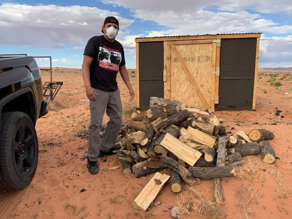 (Courtesy of Louis Williams) Louis Williams dropping off donated firewood with Heat Diné Homes.