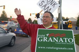 (Al Hartmann  |  Tribune file photo)  Democratic candidate for U.S. Senate Sam Granato waves at cars along Foothill Drive and 1300 South in 2010. Granato died Wednesday at age 67.