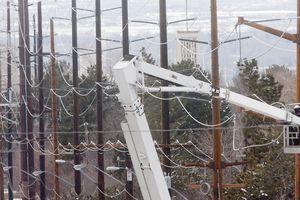 (Steve Griffin | Tribune file photo) A Rocky Mountain Power crew works on power lines in Salt Lake City in 2013. Rates will drop about 0.7% in January, Rocky Mountain Power announced in a news statement Thursday.