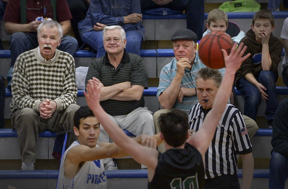 (Leah Hogsten | The Salt Lake Tribune) l-r Cyprus High School former students, coaches and boosters, Glen Rupp, Dennis Dea and Sonny Sudbury take in a basketball game. Cyprus High School has grown and changed since the gym and what may be the state's oldest operating indoor pool were constructed in 1955. A new school is in the works, badly needed to accommodate a growing population on the west side's close-knit community, where long-time fans show up no matter how good or bad the Pirates are.