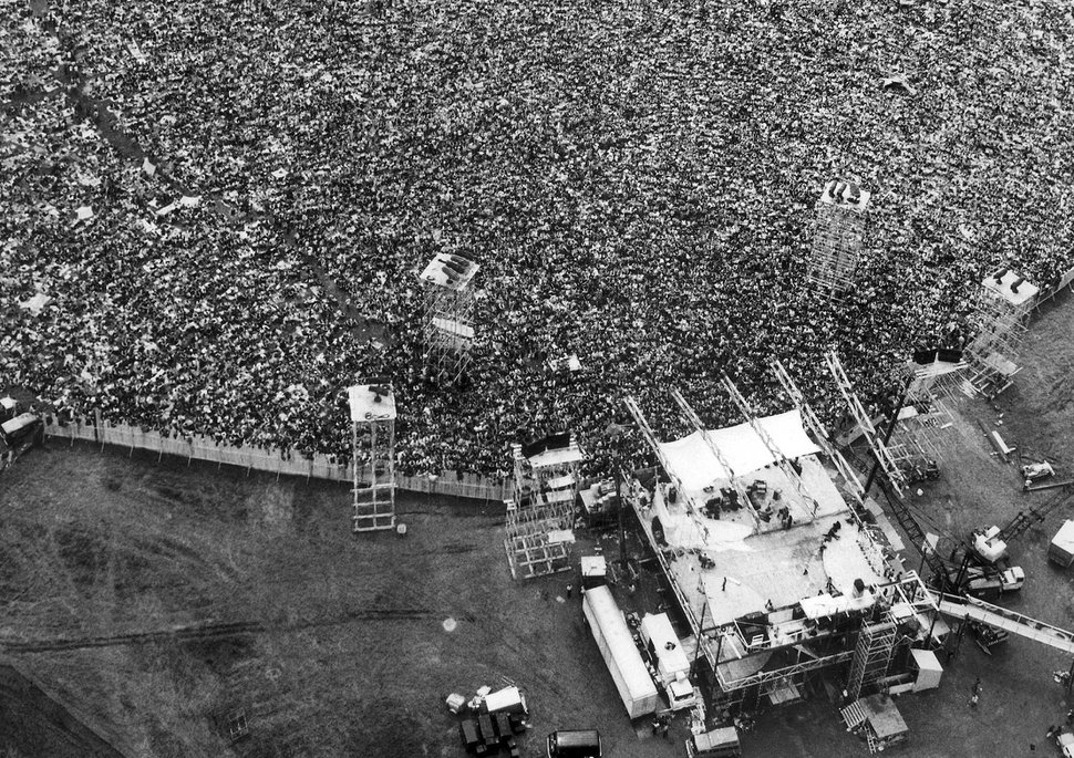 (Associated Press file photo | Marty Lederhandler) In this Aug. 16, 1969, aerial photo, music fans pack around the stage at the original Woodstock Music and Arts Festival, lower right, in Bethel, N.Y.