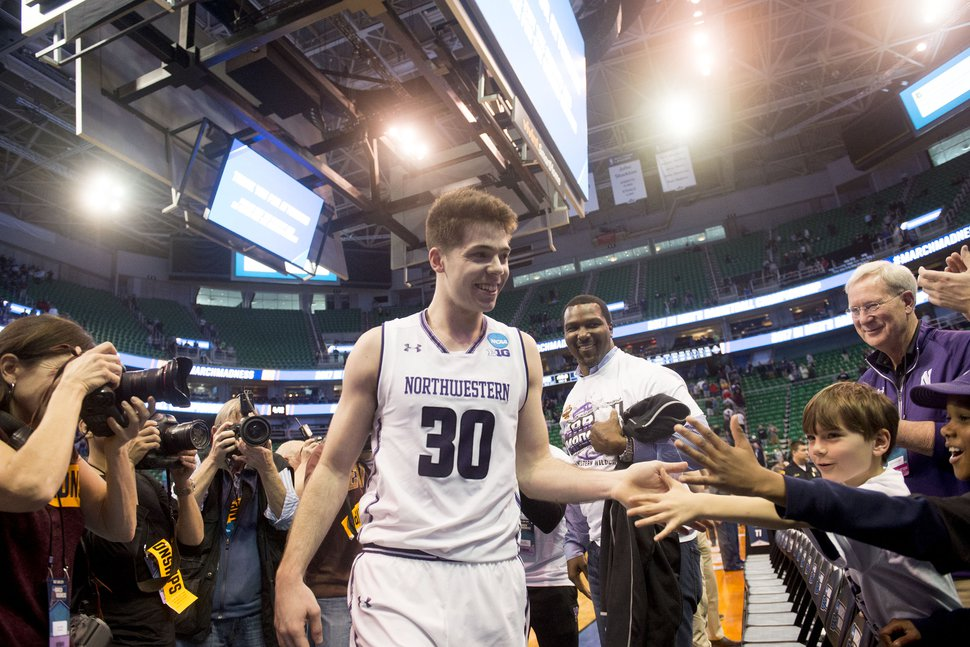 Chris Detrick | The Salt Lake Tribune Northwestern Wildcats guard Bryant McIntosh (30) high fives dans after beating Vanderbilt during the first round of the NCAA Tournament in Salt Lake City on Thursday, March 16, 2017.