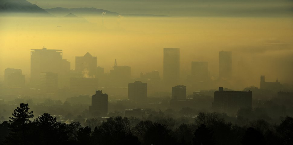 The Salt Lake City skyline is obscured by dense fog as an inversion settles over the valley Tuesday Dec. 26, 2017. Authorities say dense fog and air pollution are combining to create hazardous conditions in the Salt Lake City area. (Steve Griffin/The Salt Lake Tribune via AP)