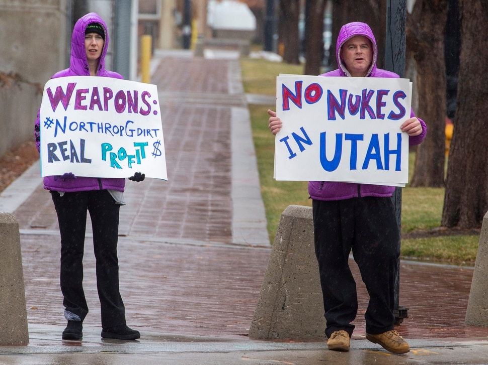(Rick Egan | The Salt Lake Tribune) Chelsea Page and Marcus Collonge hold signs during a picketing party against Northrop Grumman, on 400 West and 100 South across from the Clark Planetarium in Salt Lake City, Sunday, Dec. 8, 2019.