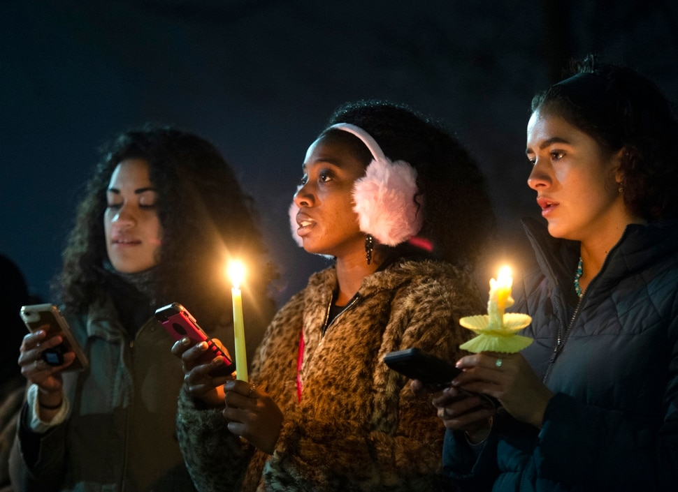(Rick Egan | The Salt Lake Tribune) Losa Smith, Jodian Grant, Joanna Hildreth-Castrejon sing with the BYU Women of Color club, during a candlelight vigil on BYU campus, for the student who died by suicide this week, at the Tanner Building, Friday, Dec. 7, 2018.