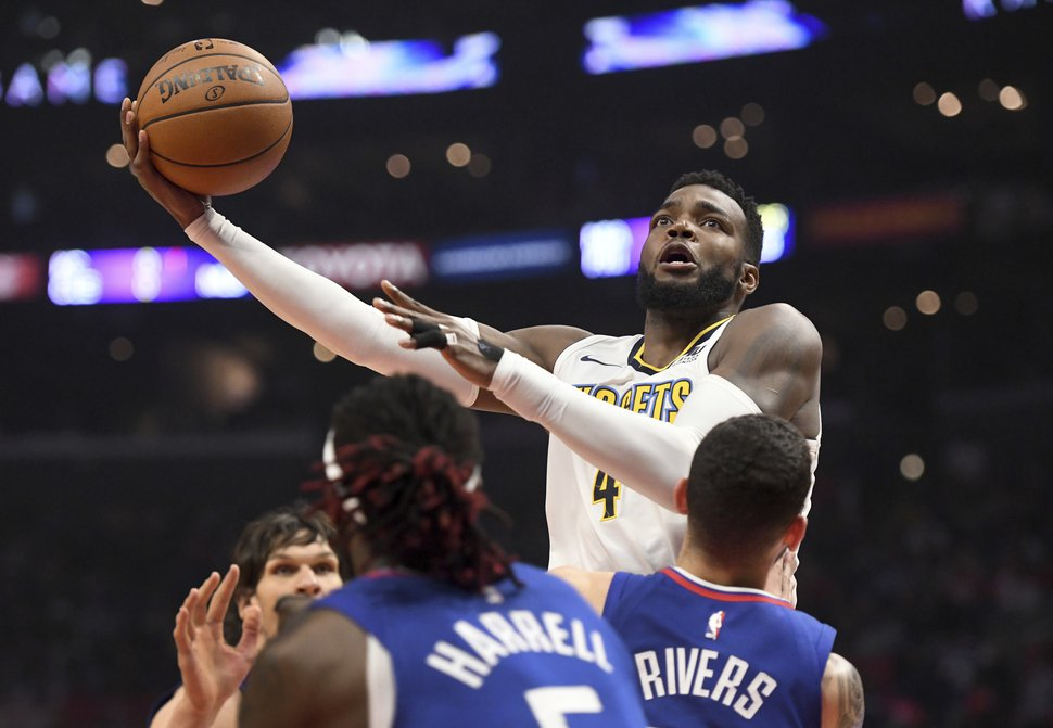 Denver Nuggets forward Paul Millsap shoots against the Los Angeles Clippers during the first half of an NBA basketball game Saturday, April 7, 2018, in Los Angeles. (AP Photo/Michael Owen Baker)