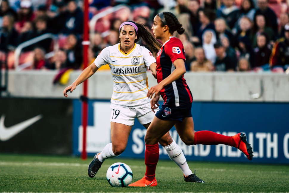 (Photo courtesy of Utah Royals FC) Rookie defender Michelle Maemone tracks a Washington Spirit player during the Royals' home opener at Rio Tinto Stadium on April 20, 2019 in Sandy, Utah.
