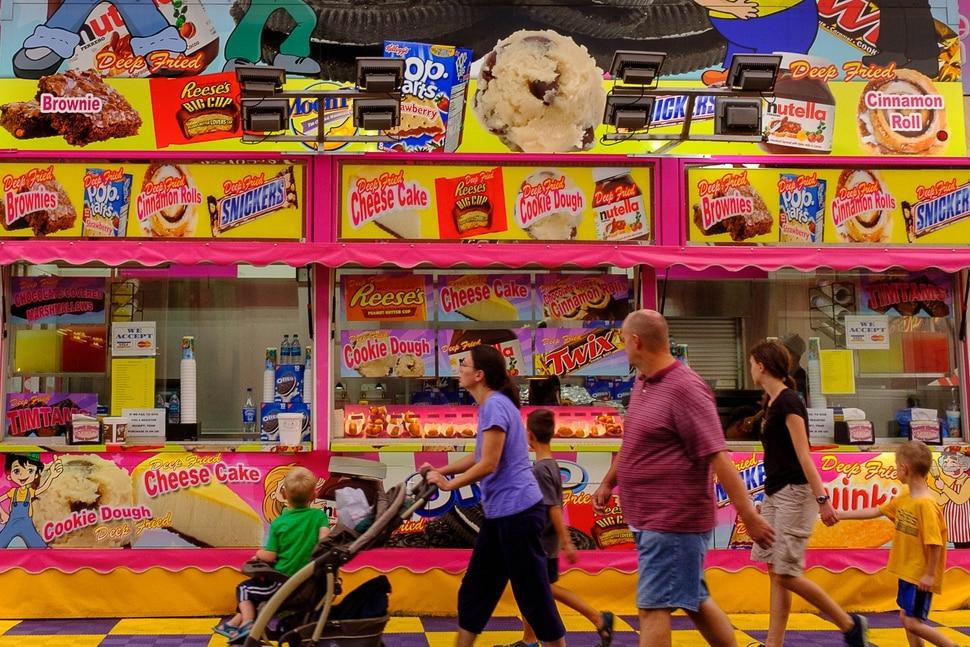 (Trent Nelson   The Salt Lake Tribune) A family takes in the sweet offerings on opening day at the Utah State Fair in Salt Lake City, Thursday September 7, 2017.