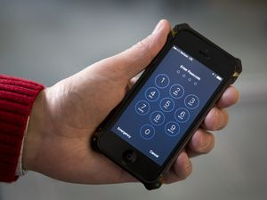 (Carolyn Kaster | AP file photo) In this Feb. 17, 2016, file photo an iPhone is seen in Washington. The Utah Legislature has passed an anti-porn bill that would require manufacturers to activate content filters upon purchase.