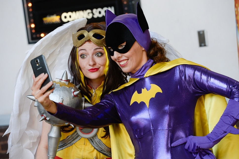 (Francisco Kjolseth | The Salt Lake Tribune) Mother and daughter superhero duo Ruth Barnum, left, and Bekcy Barnum join the fun for FanX's twice-annual press conference, drawing cosplayers to Megaplex Jordan Commons in Sandy on Wed. June 12, 2019, for the announcement of the event's celebrity visitors.