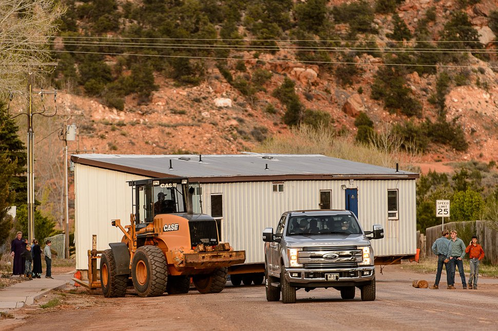 (Trent Nelson | Tribune file photo) A group of FLDS members move a modular home from a lot in Hildale as part of an eviction from UEP trust property on Wednesday, April 5, 2017. Many FLDS members have refused to cooperate with the state-controlled land trust and are now facing eviction.