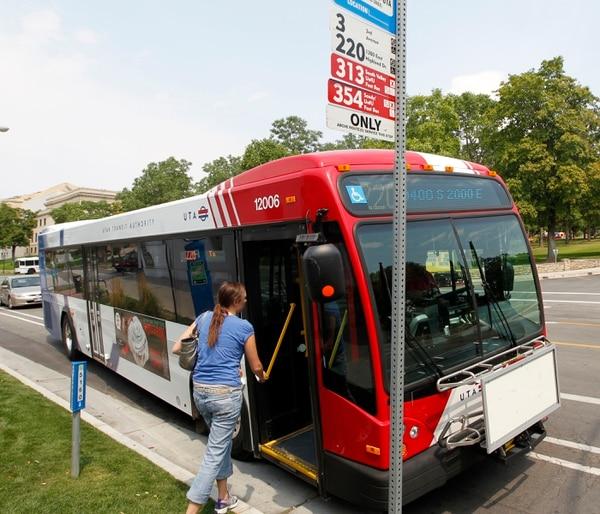 Al Hartmann | The Salt Lake Tribune Student climbs aboard UTA bus at President's Circle stop at the University of Utah Monday August 13 2012.