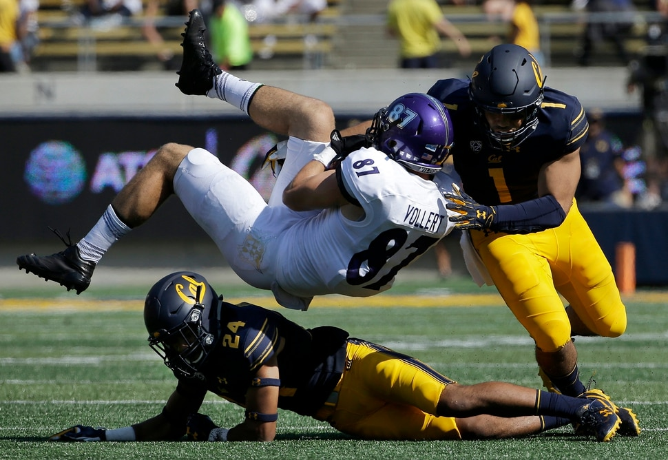 Weber State tight end Andrew Vollert (87) is tackled after catching a pass between California cornerback Camryn Bynum (24) and linebacker Devante Downs (1) during the first half of an NCAA college football game in Berkeley, Calif., Saturday, Sept. 9, 2017. (AP Photo/Jeff Chiu)