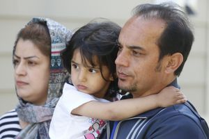 (Rick Bowmer   The Associated Press) In this April 22, 2020, photo, Afghan refugee Mahmood Amiri poses with daughter Safa, and his wife Masouda, in West Valley City, Utah. Coronavirus restrictions have affected refugee families in the same ways as anyone else — job losses, child care challenges — but many are navigating the turmoil in a language they don't fully understand and without extended family or close friends to help. Amiri arrived in the United States more than a month ago, but his children are still waiting for their first day at school and the family has yet to go to the mosque to meet fellow Muslim families.