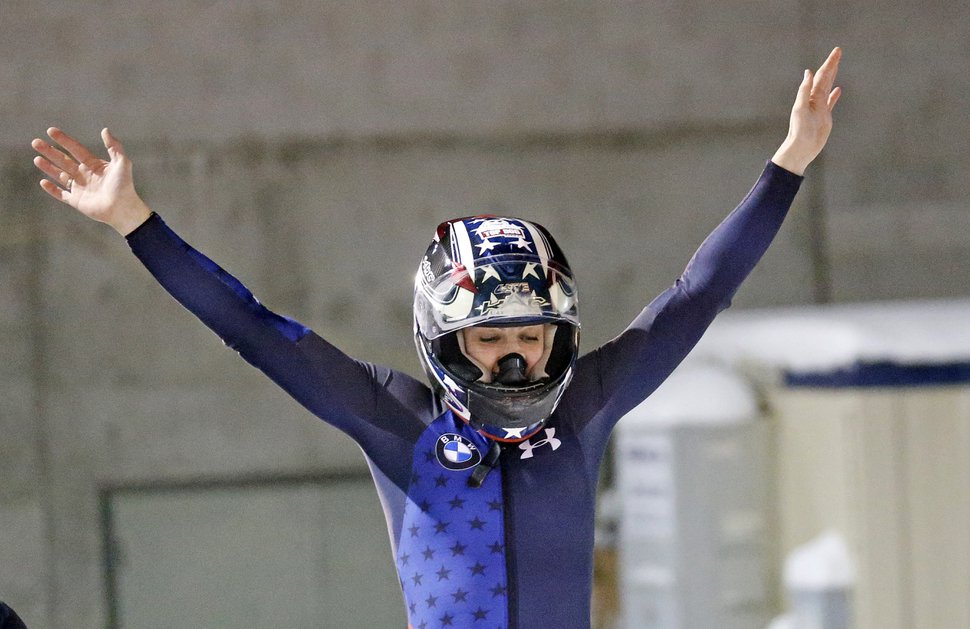 Jamie Greubel Poser celebrates after she and Lauren Gibbs won the women's bobsled World Cup race Friday, Nov. 17, 2017, in Park City, Utah. (AP Photo/Rick Bowmer)