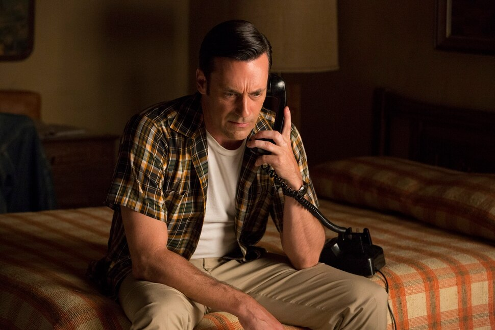 In this image released by AMC, Jon Hamm portrays Don Draper in a scene from Mad Men. Hamm is nominated for an Emmy Award for outstanding lead actor in a drama series. The 67th annual Primetime Emmy Awards will be held on Sunday, Sept. 20, 2015, in Los Angeles. (Michael Yarish/AMC via AP)