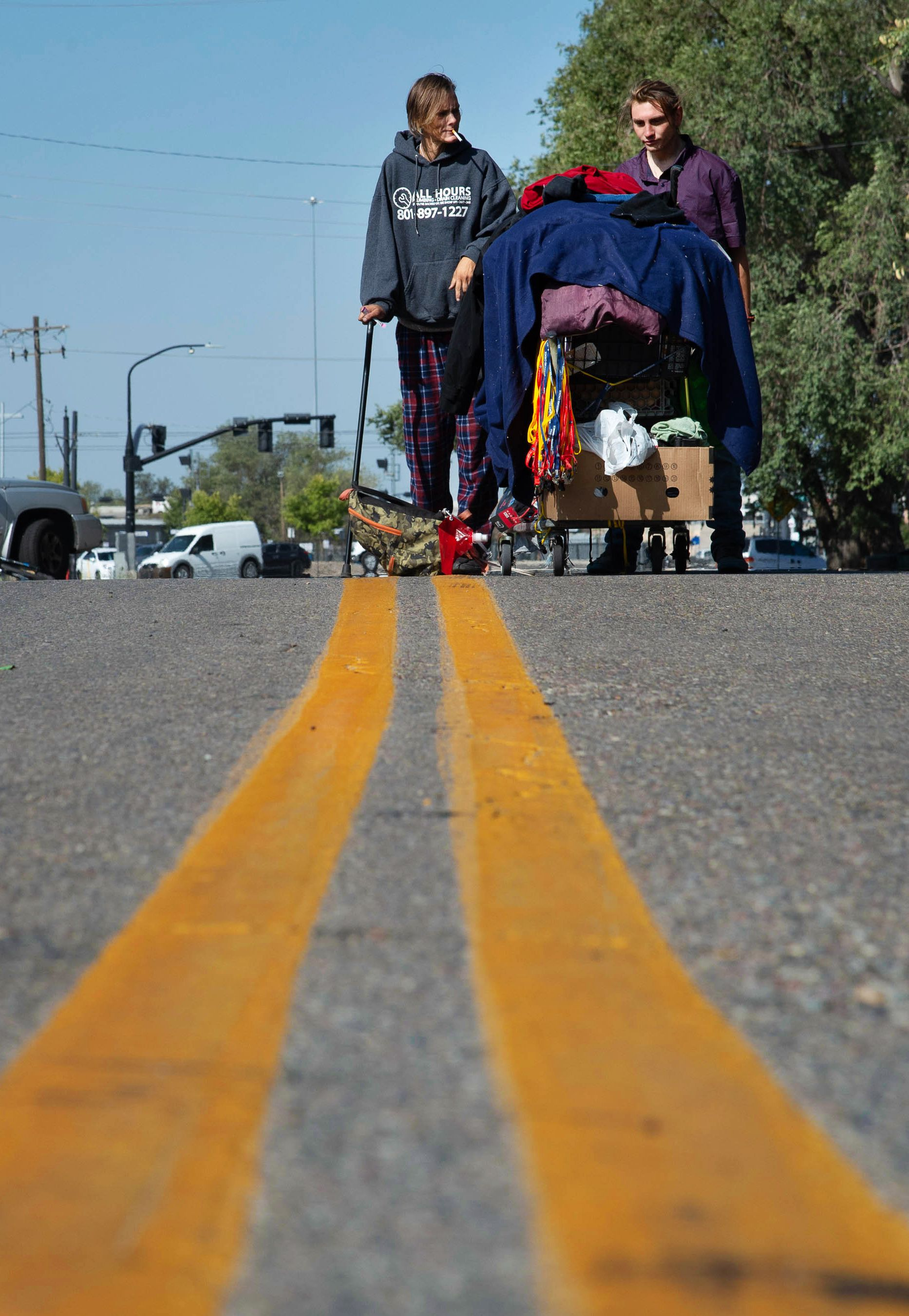 (Francisco Kjolseth  |  The Salt Lake Tribune) People prepare themselves for plans by the Salt Lake County Health Department to clean up homeless camps on Thursday, Sept. 10, 2020, as they gather their belongings near the former Road Home Shelter.