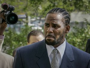 """(Charles Rex Arbogast   AP Photo) This photo from Friday May 9, 2008, shows R. Kelly arriving for the first day of jury selection in his child pornography trial at the Cook County Criminal Courthouse in Chicago. R. Kelly, the R&B superstar known for his anthem """"I Believe I Can Fly,"""" was convicted Monday in a sex trafficking trial after decades of avoiding criminal responsibility for numerous allegations of misconduct with young women and children."""