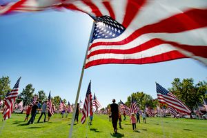 (Francisco Kjolseth  |  The Salt Lake Tribune) The Utah Healing Field marks the 19th anniversary of the 9/11 attacks, as as people visit the 1500 flags on the promenade outside Sandy City Hall on Friday, Sept. 11, 2020. This year the flags are spaced out more than they have in the past to allow for social distancing among people who visit the display.